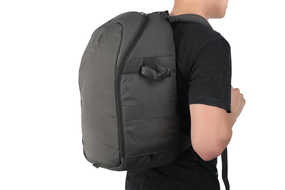 black backpack on young man